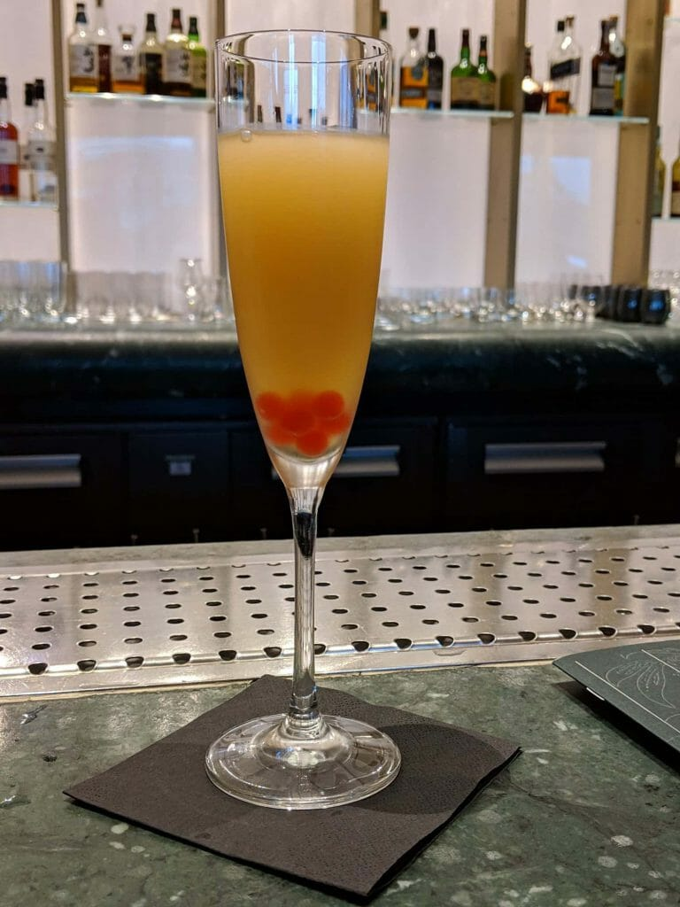 """Century Fizz (bartender's recommendation): Porter's Tropical Old Gin, Martini Rubino, parsnip honey, tinned peach, lacto carrot, ginger. Summarized as """"Session hi-ball"""" and """"Party"""" on the menu."""